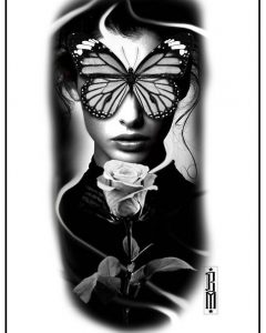 woman with butterfly and rose tattoo