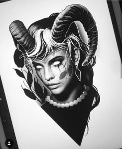 woman with horns tattoo idea