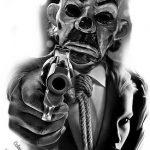 joker mask with gun chicano tattoo
