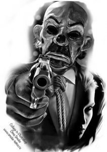 joker mask with gun chicano tattoo