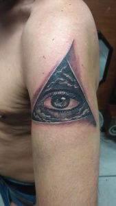 all seeing eye tattoo in triangle with clouds