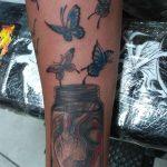 heart in jar with butterflies tattoo in london