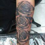 three roses tattoo on woman arm