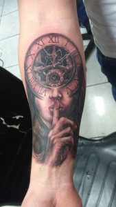 shhh woman with clock tattoo