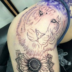 tiger cover up tattoo thigh